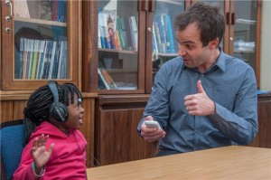 De Wet Swanepoel, PhD, testing a 4-year-old with hearScreen, a smart phone app. Photo credit: University of Pretoria.