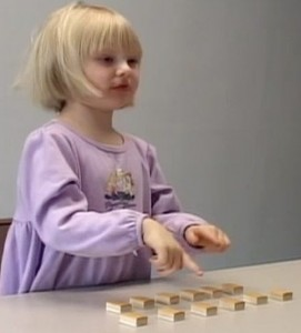 Using gestures helps children develop basic learning and cognitive skills, aiding them in problem-solving tasks. Photo courtesy of Laura Tharsen/Susan Goldin-Meadow Lab.