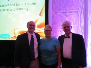Hearing Review Editor Karl Strom with Patricia Connelly, PhD, and Thomas Higgins, ACA, BC-HIS, who are husband and wife. Higgins received this year's Hearing Review Professional Leadership Award for his leadership of IHS during the past year as president.