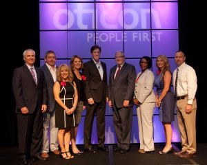 Left to right:  Jim Kothe, MS, Oticon VP of Sales; Don Schum, PhD, VP of Audiology & Professional Relations; Nancy Palmere, Senior Marketing Manager; Marija Baranauskas, AuD, Director of Education and Training; behavioral scientist James Kane, keynote speaker; Oticon President Peer Lauritsen; Sheena Oliver, VP of Marketing and Mike Irby, Manager of Business Development.