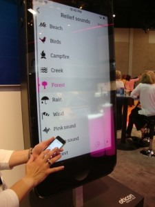 A Cell Phone Displays ConnectLine App from Oticon.