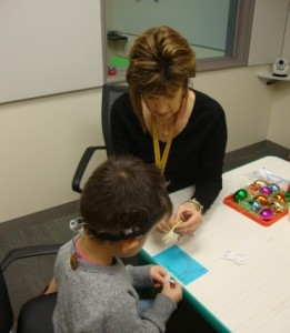 Auguste works with Educational Specialist Debra Schrader